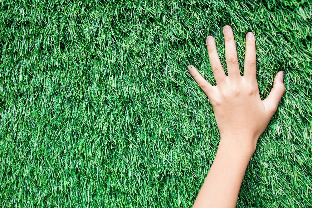 hands on grass
